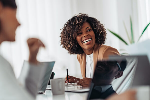 Woman laughing in meeting